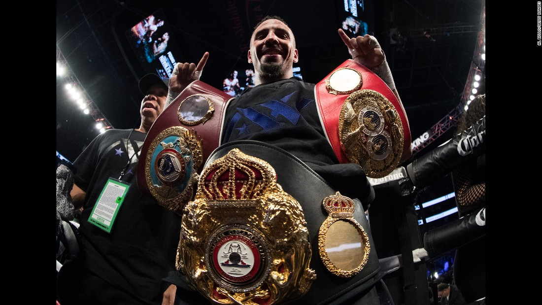 Andre Ward celebrates with three title belts after winning a unanimous decision over Sergey Kovalev on Saturday, November 19. The two light-heavyweights came into the bout undefeated. Ward won narrowly on all three scorecards (114-113).