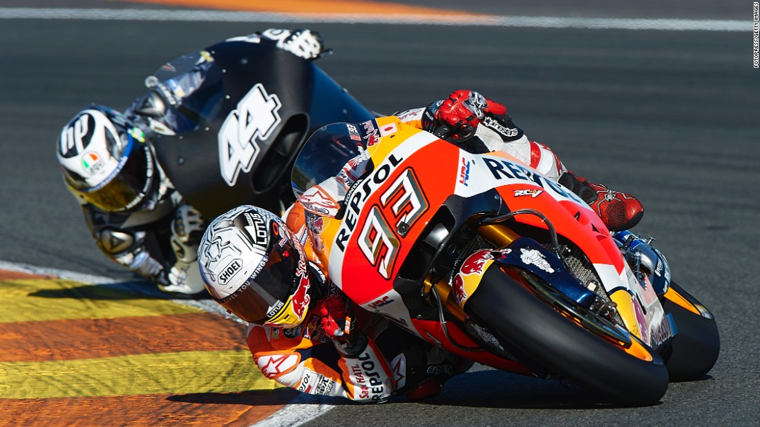 Marc Marquez, right, rounds a corner during MotoGP testing in Valencia, Spain, on Tuesday, November 15. Marquez recently won his third championship on the circuit.