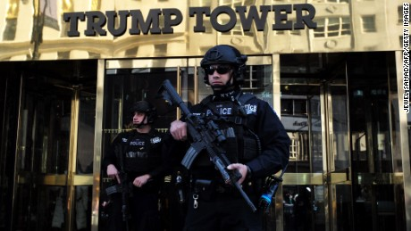 New York Police Department (NYPD) officers guard the main entrance of the Trump Tower, where US President-elect Donald Trump holds meetings, in New York on November 14, 2016.
