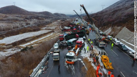 The road was blocked as rescuers worked to free those trapped.