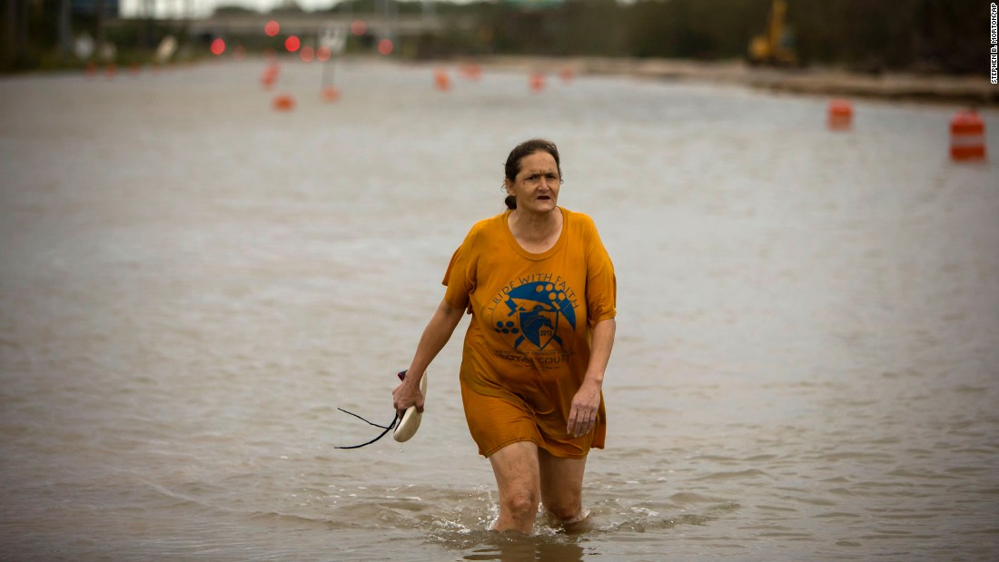 A woman walks along a flooded street in Savannah, Georgia, after Hurricane Matthew hit on Saturday, October 8.