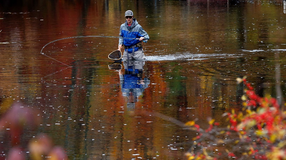 Griffin Nyhan tries to catch salmon while fly fishing on the Merrymeeting River in Alton, New Hampshire, on Saturday, October 22.