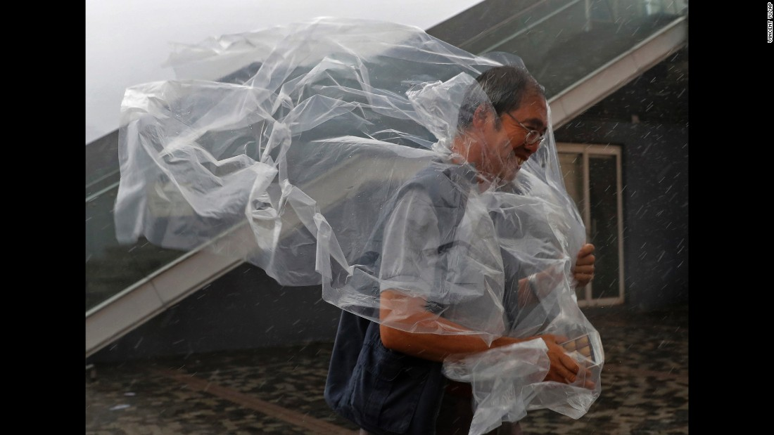 "A man braves the wind on the Victoria Harbour waterfront as <a href=""http://www.cnn.com/2016/10/20/asia/hong-kong-typhoon-haima/"" target=""_blank"">Typhoon Haima</a> approaches Hong Kong on Friday, October 21."