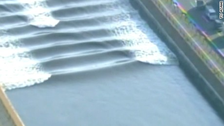 """A """"tidal bore"""" forced by Monday's  tsunami in eastern Japan moves through a canal."""