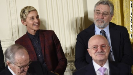 Actor Robert DeNiro(R) waits next to Ellen DeGeneres(C) before US President Barack Obama presents the Presidential Medal of Freedom, the nation's highest civilian honor, during a ceremony in the East Room of the White House in Washington, DC, November 22, 2016. / AFP / SAUL LOEB        (Photo credit should read SAUL LOEB/AFP/Getty Images)