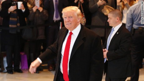 President-elect Donald Trump walks past a crowd as he leaves the New York Times building following a meeting, Tuesday, Nov. 22, 2016, in New York. (AP Photo/Mark Lennihan)