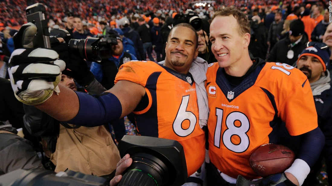 Denver Broncos offensive lineman Ryan Harris takes a selfie with quarterback Peyton Manning after the Broncos won the AFC Championship on Sunday, January 24. The Broncos went on to win the Super Bowl, and then Manning retired.