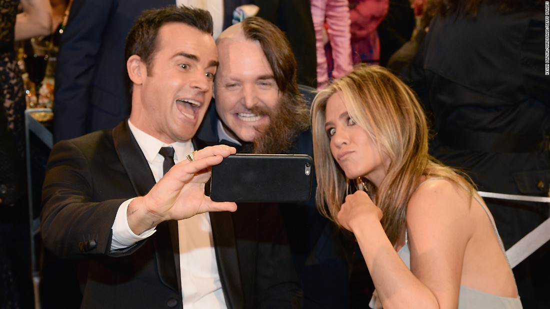 From left, actors Justin Theroux, Will Forte and Jennifer Aniston take a photo at the Critics' Choice Awards on Sunday, January 17.