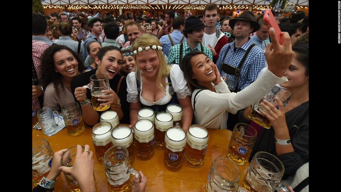 Visitors enjoy the Oktoberfest beer festival in Munich, Germany, on Saturday, September 17.
