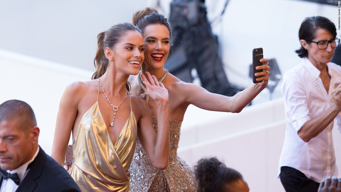 Models Izabel Goulart, left, and Alessandra Ambrosio take a selfie at the Cannes Film Festival on Friday, May 20.