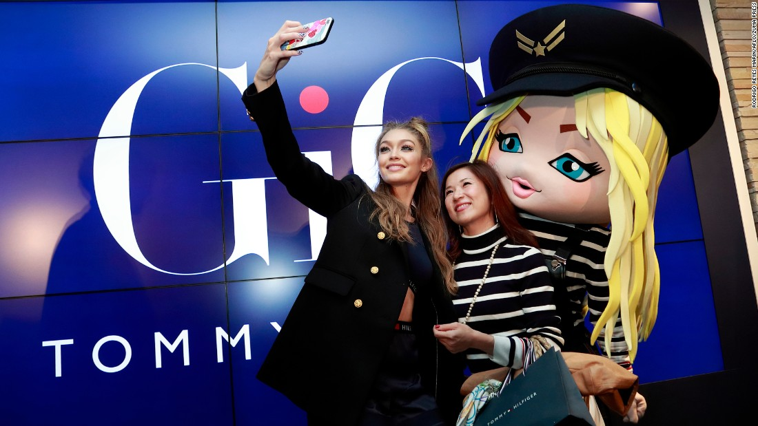 Model Gigi Hadid takes a selfie with a fan in Tokyo during the launch of her Tommy Hilfiger collaboration on Wednesday, October 12.