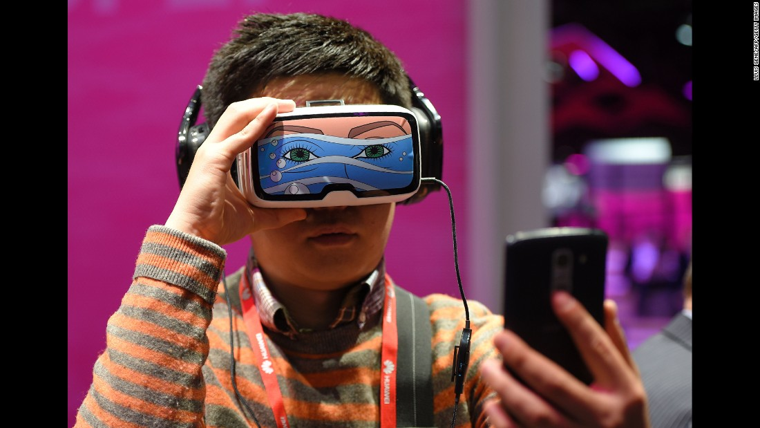 A boy takes a selfie as he tests the Oculus VR, a virtual reality headset, in Barcelona, Spain, on Monday, February 22. It was the first day of the Mobile World Congress.