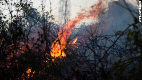 A wildfire burns in Zikhron Ya'akov, Israel, Wednesday, November, 23. Due to dry conditions, wildfires broke out for the second day in Israel. In Zikhron Ya'akov around ten homes were burned and about fifteen people sustained light injuries from smoke inhalation.