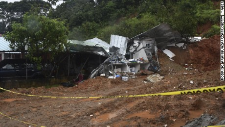 View of the damage caused by a mudslide which killed two people in the community of Arraijan, 25 km from Panama City, on November 22, 2016. Tropical Storm Otto, that is expected to become a full-on hurricane in the Caribbean, was lurching toward Central America on Tuesday, with its rainy fringe already causing three deaths in Panama and prompting coastal evacuations in Costa Rica. In Panama, three people died from a mudslide and a falling tree provoked by the first outer dump of Otto's heavy rains, the head of the National Civil Protection Service, Jose Donderis, told AFP.  / AFP / Rodrigo ARANGUA        (Photo credit should read RODRIGO ARANGUA/AFP/Getty Images)