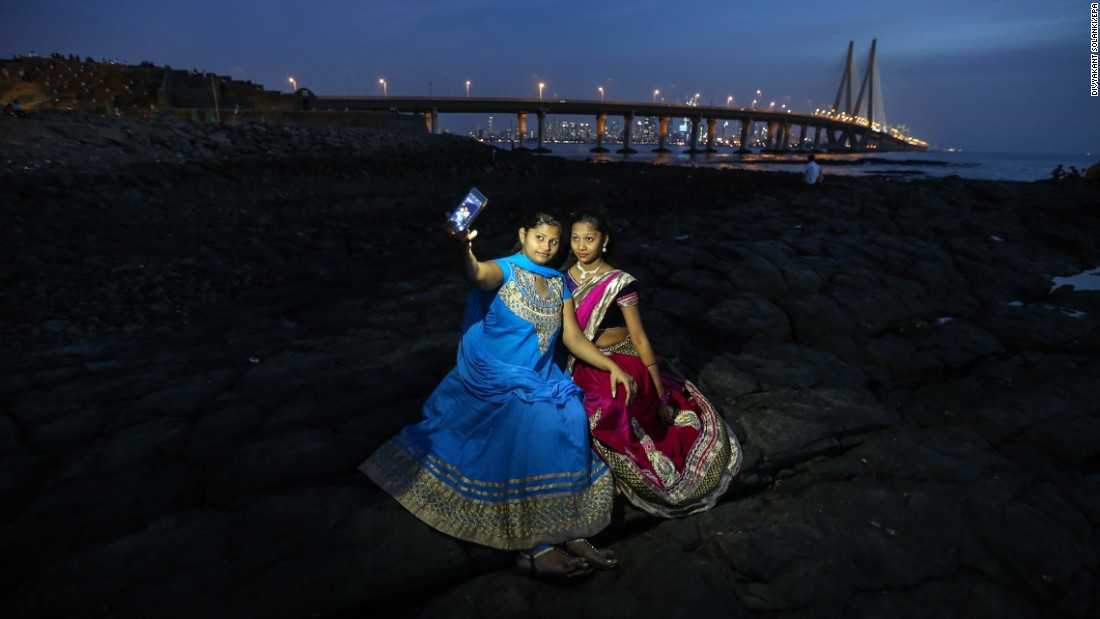 People take selfies at the Bandra Fort bandstand, a famous tourist spot in Mumbai, India, on Thursday, February 25.