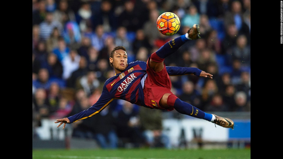 Neymar, a forward for FC Barcelona, concentrates on the ball during a Spanish league match against city rivals Espanyol on Saturday, January 2.
