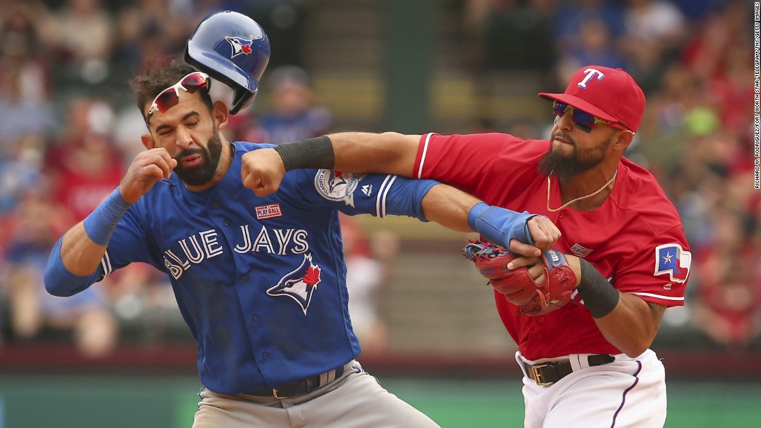 "Texas second baseman Rougned Odor, right, punches Toronto outfielder Jose Bautista during a Major League Baseball game in Arlington, Texas, on Sunday, May 15. The confrontation, <a href=""http://bleacherreport.com/articles/2640341-jose-bautista-rougned-odor-and-more-ejected-after-blue-jays-vs-rangers-brawl"" target=""_blank"">which sparked a bench-clearing brawl,</a> came after the base-running Bautista slid hard into second to try to break up a double play. Both players were ejected, as were several others involved in the brawl afterward."