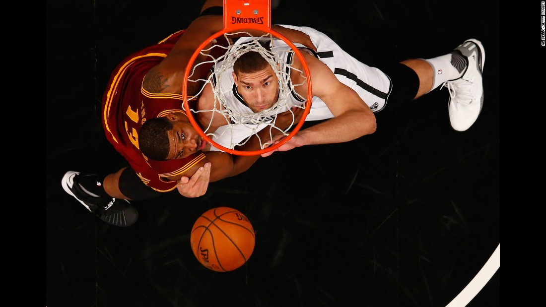 Brooklyn center Brook Lopez, right, battles Cleveland's Tristan Thompson for a rebound during an NBA game in New York on Wednesday, January 20.