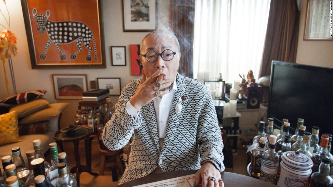 Essayist, barman and former editor-in-chief of Japanese Playboy magazine Katsuhiko Shimaji is photographed here in his home in Tokyo, surrounded by his whiskey collection.