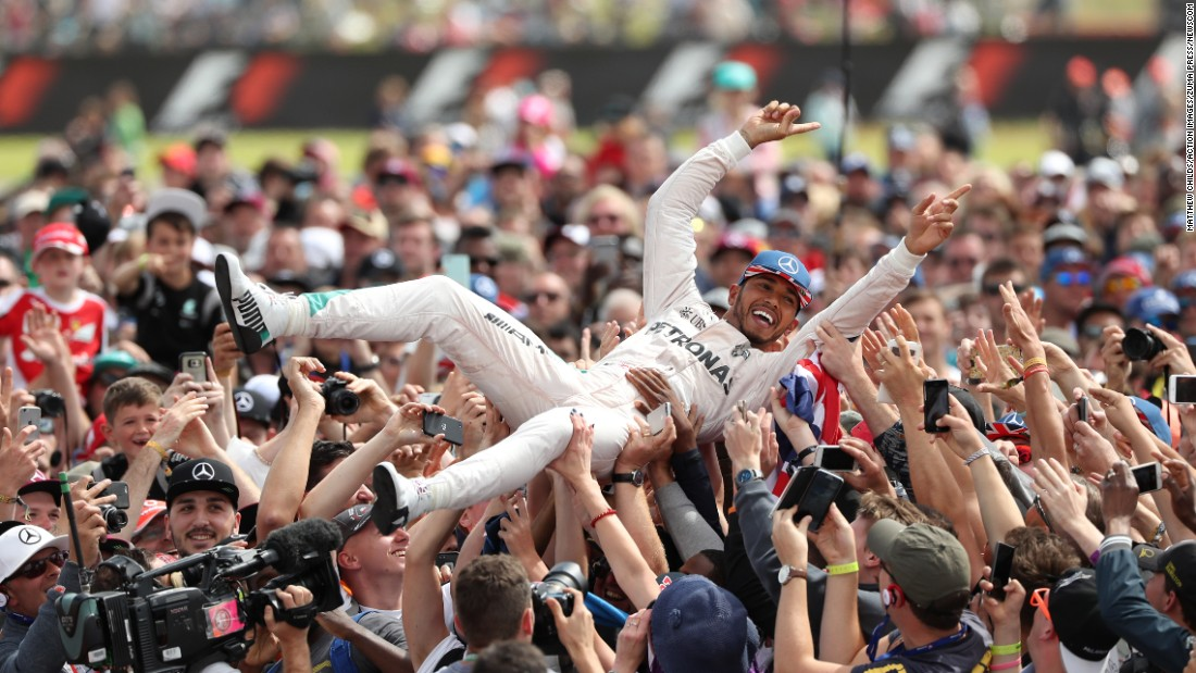 Formula One driver Lewis Hamilton crowd-surfs after his victory at the British Grand Prix on Sunday, July 10. This was his fourth time winning the race.