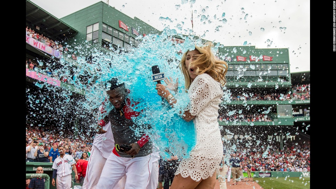 "TV reporter Guerin Austin is an unlucky bystander as David Ortiz is doused by his Boston teammates on Saturday, May 14. Ortiz had just won a game with a base hit. Austin <a href=""https://twitter.com/guerinaustin/status/731925964687572992"" target=""_blank"">was good-natured about the incident on Twitter</a> and wore a light-blue raincoat the next day."