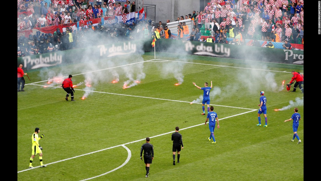 "Flares, thrown onto the field from the stands, <a href=""http://www.cnn.com/2016/06/17/football/gallery/euro-2016-day-8/index.html"" target=""_blank"">interrupt the Euro 2016 match</a> between Croatia and the Czech Republic on Friday, June 17."