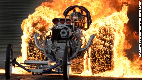 WELLINGBOROUGH, ENGLAND - JULY 16: Flame burn-out exhibition by Bob Hawkins in his Slingshot Dragster time Traveller at Santa Pod Raceway on July 16, 2016 in Wellingborough, England. (Photo by Leo Mason - Split Second/Corbis via Getty Images)