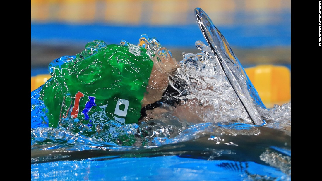 South African swimmer Christopher Reid competes in the 100-meter backstroke during the Olympic Games on Sunday, August 7.