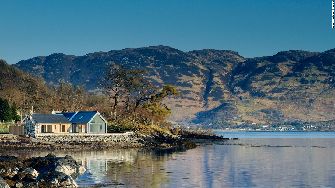 This Rural Design/R.HOUSE collaboration is situated on the edge of Loch Duich, featuring a stunning view of the famous Eilean Donan Castle.