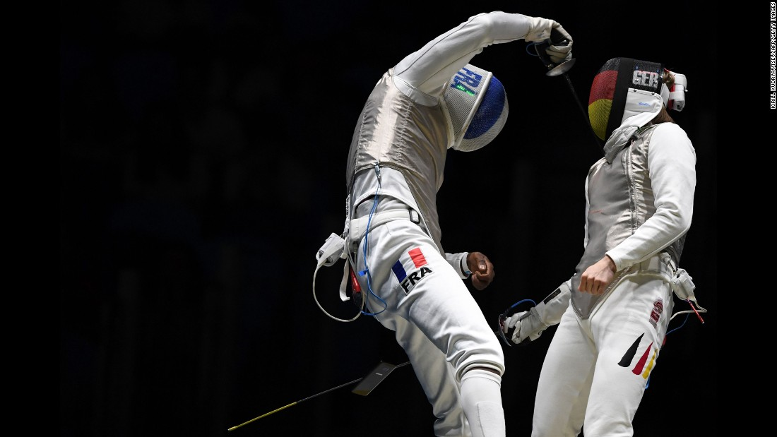 "A cell phone<a href=""http://www.cnn.com/2016/08/09/sport/french-fencer-drops-phone/"" target=""_blank""> falls out of the pocket of French fencer Enzo Lefort</a> as he competes against Germany's Peter Joppich during the Olympics on Sunday, August 7."
