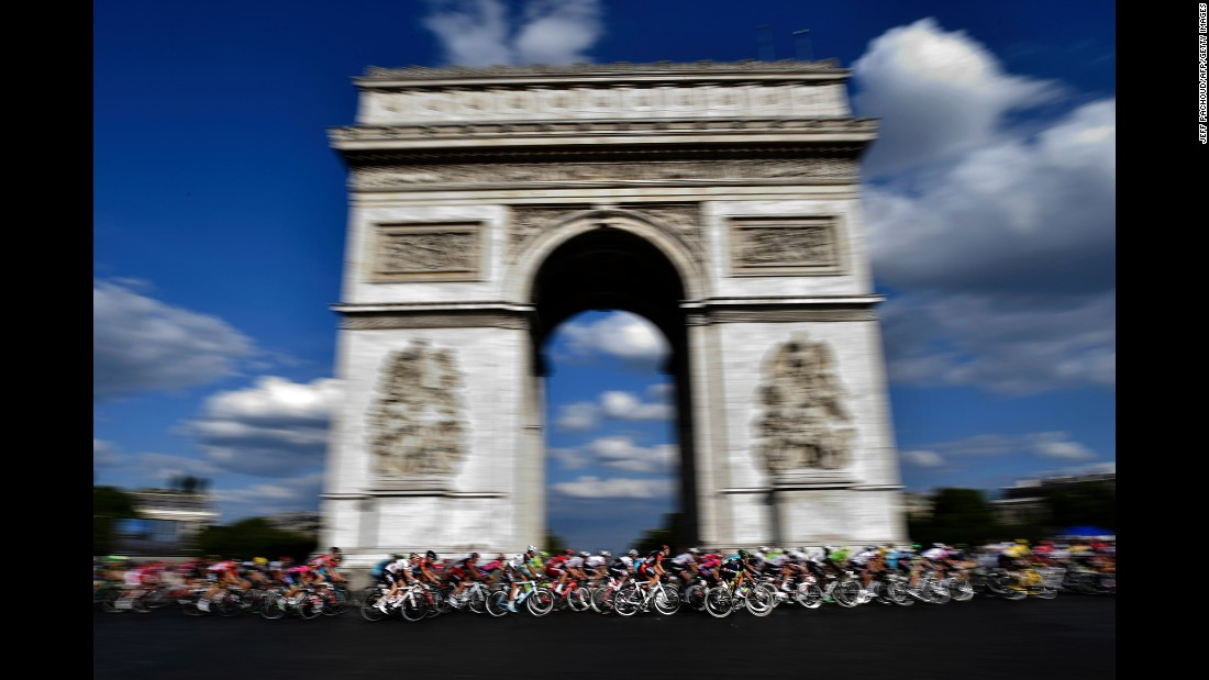 Cyclists race past the Arc de Triomphe in Paris during the last stage of the Tour de France on Sunday, July 24.