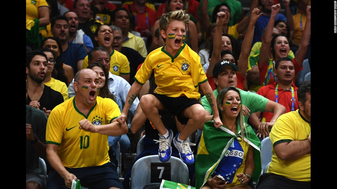 Brazil fans cheer on their women's volleyball team during an Olympic quarterfinal match against China on Wednesday, August 17.