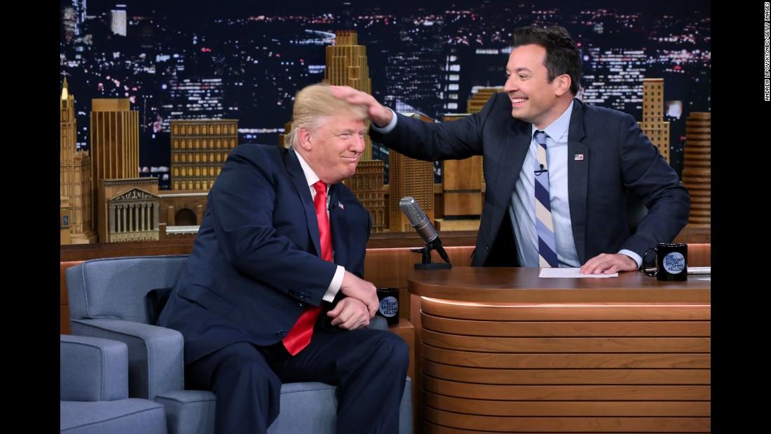 "Talk-show host Jimmy Fallon <a href=""http://www.cnn.com/2016/09/15/politics/donald-trump-jimmy-fallon-tonight-show/"" target=""_blank"">musses Donald Trump's hair </a>during an episode of ""The Tonight Show"" on Thursday, September 15."