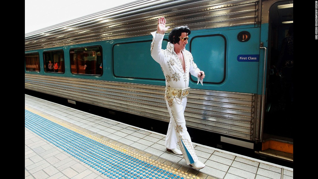 An Elvis impersonator prepares to board a train in Sydney on Thursday, January 7. The Parkes Elvis Festival is held annually in Australia to coincide with the late icon's birthday.