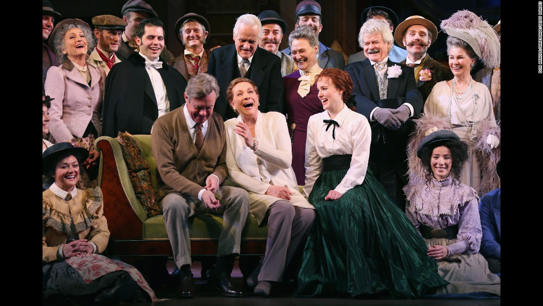 "Director Julie Andrews, center front, laughs with cast members of ""My Fair Lady"" during a media call at the Sydney Opera House on Thursday, September 1."