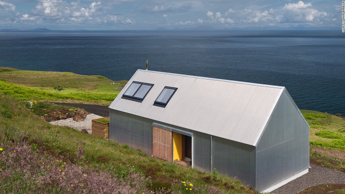 "Rural Design's Tinhouse is located in Northern Skye. Dickson is a big fan of the building's iron exterior: ""It also it reminds me of things like air-streamed caravans and that kind of optimism of the 1960's,"" the architect says."