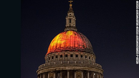 LONDON, ENGLAND - AUGUST 30:  Flames are projected on to the dome of St Paul's Cathedral, as seen from the roof terrace of One New Change, as a rehearsal for the London's Burning Festival which will take place on Sunday commemorating the Great Fire of London at St Paul's Cathedral on August 30, 2016 in London, England. The anniversary of the 1666 Great Fire of London will be celebrated in the capital with events including the flames on St. Pauls Cathedral and a 120 metre long wooden sculpture of 17th century London which will be set on fire.  (Photo by Chris J Ratcliffe/Getty Images)