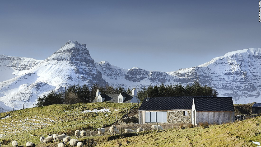 Rural Design created this two-bedroom house on the Isle of Skye's Trotternish peninsula. This modern building is on the site of a ruined Blackhouse. Embracing this history, Rural Design incorporated stone walls into the facade to strengthen this connection with Highland tradition.