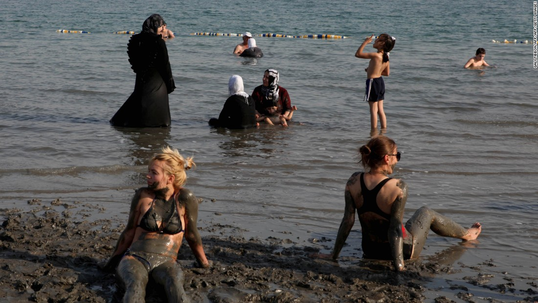 Tourists bathe in the waters of the Dead Sea in the West Bank.