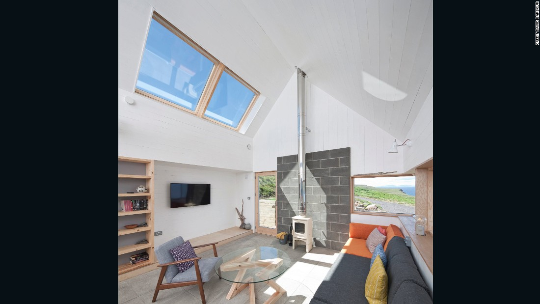 "Rural Design do take note of Scotland's unpredictable weather in their designs: ""One thing that we can't change: at the end of the day a dwelling here is a shelter from the landscape, from the wild weather,"" admits Dickson. The interiors are designed to be cosy and welcoming."