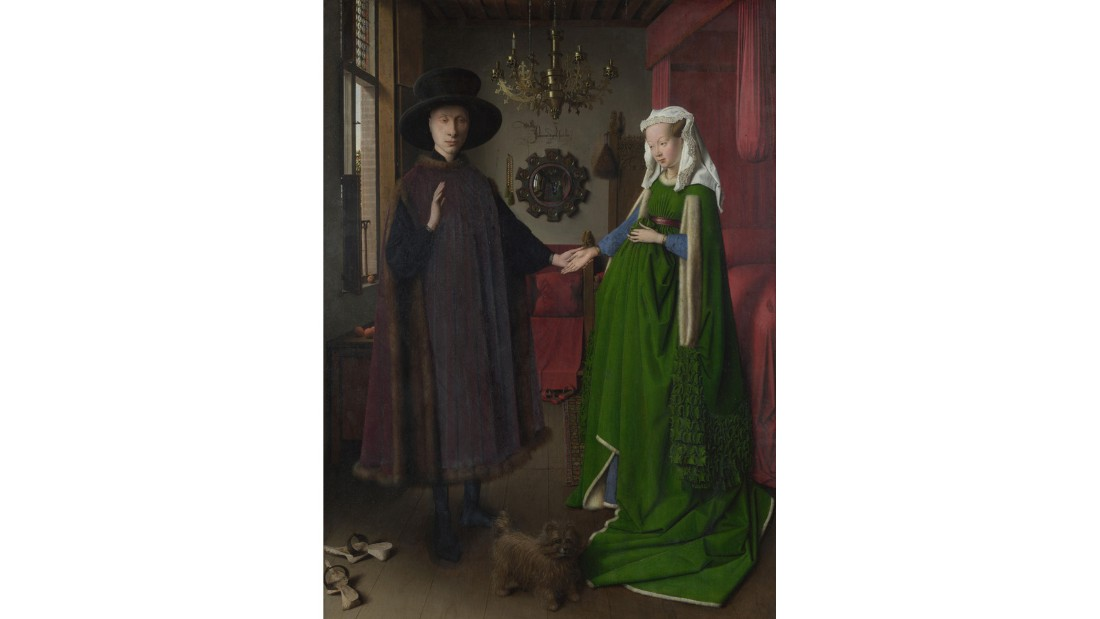 "The ornate Latin script above the mirror in the background is not an ancient expression. It's merely a cheeky translation of ""Jan van Eyck was here 1434."""