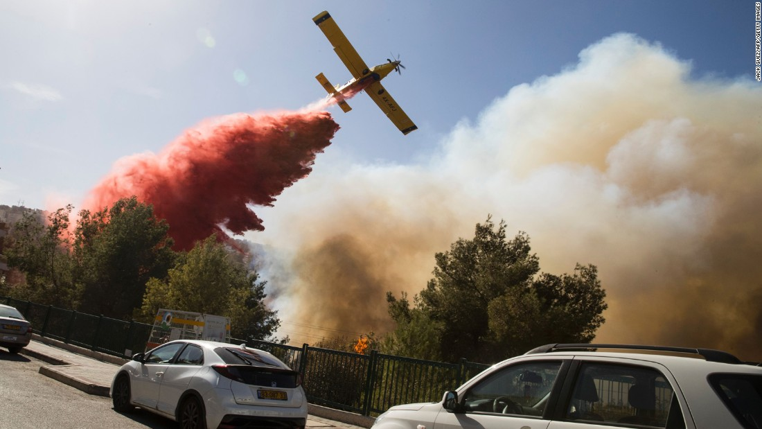 A plane drops retardant on a fire in Haifa on November 24.