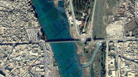 FILE PHOTO: Google Earth satellite photo of Old Bridge in Mosul, Iraq, from 2004.