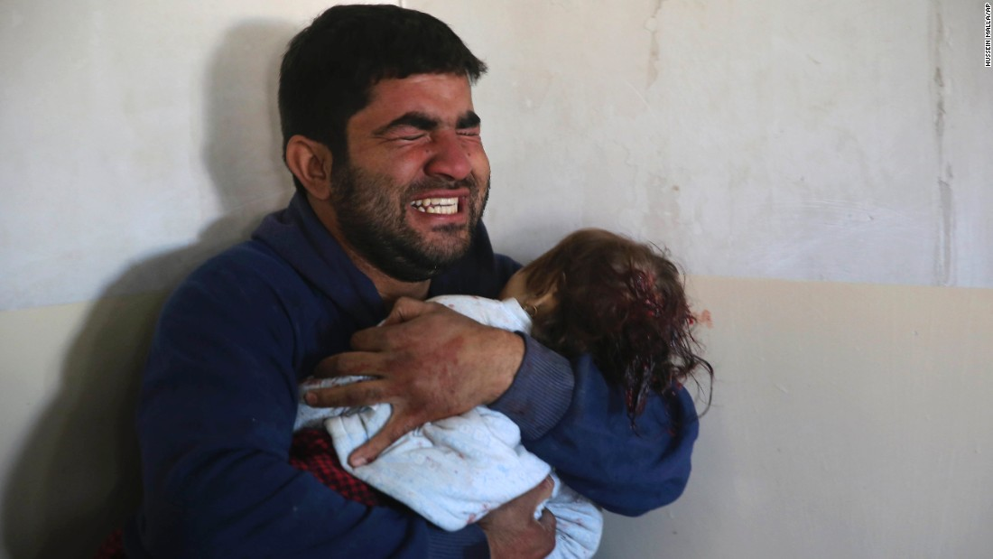 "Omar Ali grieves as he holds his 15-month-old daughter, Amira, who was killed by an ISIS mortar in Mosul, Iraq, on Wednesday, November 23. An Iraqi-led coalition is fighting ISIS <a href=""http://www.cnn.com/2016/10/17/world/gallery/mosul/index.html"" target=""_blank"">to reclaim Mosul,</a> Iraq's second-largest city and the last major stronghold for ISIS in the country."