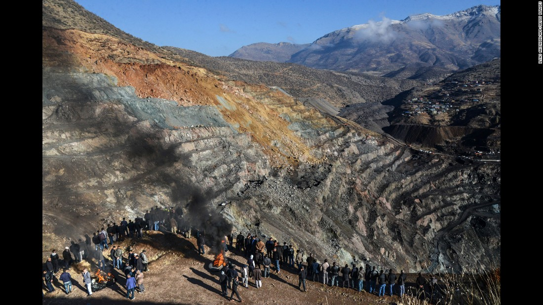 "Families of trapped miners wait as rescue workers search for their loved ones after the collapse of a copper mine in Siirt, Turkey, on Friday, November 18. At least eight bodies have been found, and eight workers remain trapped, <a href=""http://www.yenisafak.com/en/news/rescuers-find-turkish-miners-body-at-accident-site-2569667"" target=""_blank"">according to the state-run Anadolu news agency.</a>"