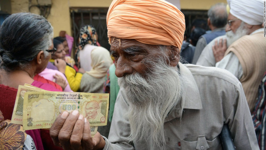 "People gather outside a bank in Amritsar, India, as they wait to deposit 500- and 1,000-rupee notes on Saturday, November 19. The government, in an attempt to fight corruption and tax evasion, is withdrawing the country's two largest notes from circulation. But the currency exchanges <a href=""http://money.cnn.com/2016/11/14/news/india/india-rupee-currency-anger/"" target=""_blank"">have overwhelmed the country's banks</a> and inconvenienced citizens."
