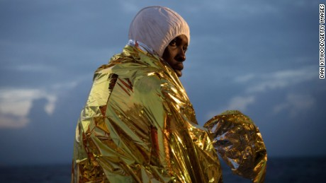 A man from West Africa tries to keep warm after being rescued from the Mediterranean in November.