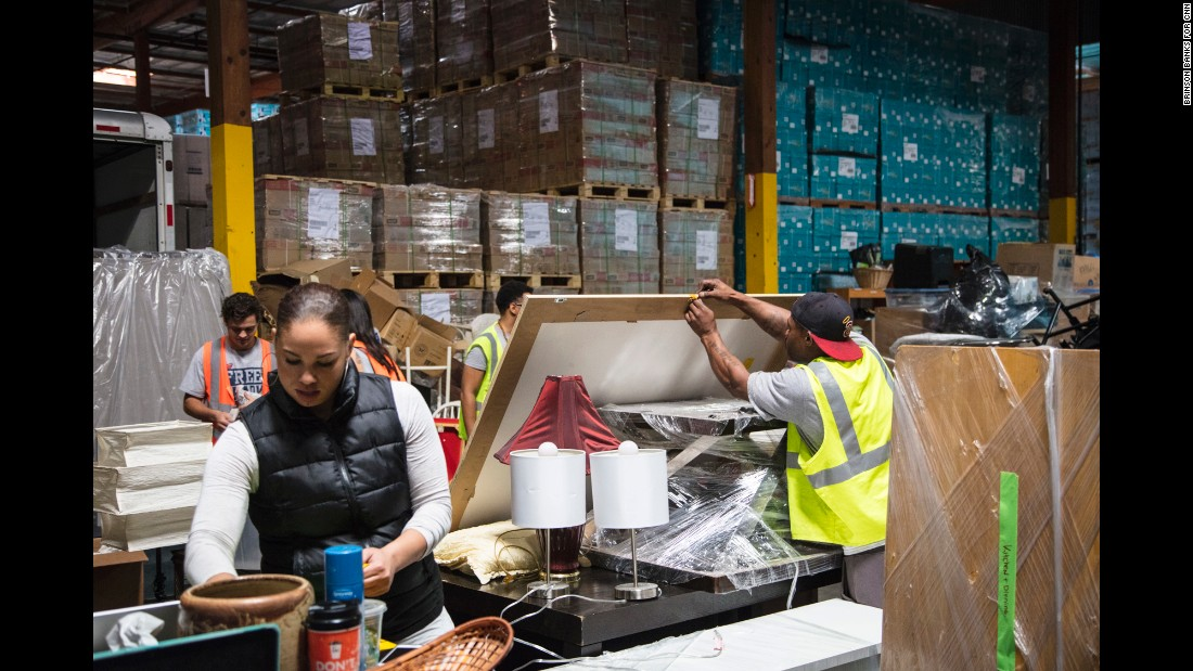 Out of this donated warehouse space in Carson, California, Smith and her team organize gifted household items that will be given to former wards of the state who may not have families to help them establish a home of their own.