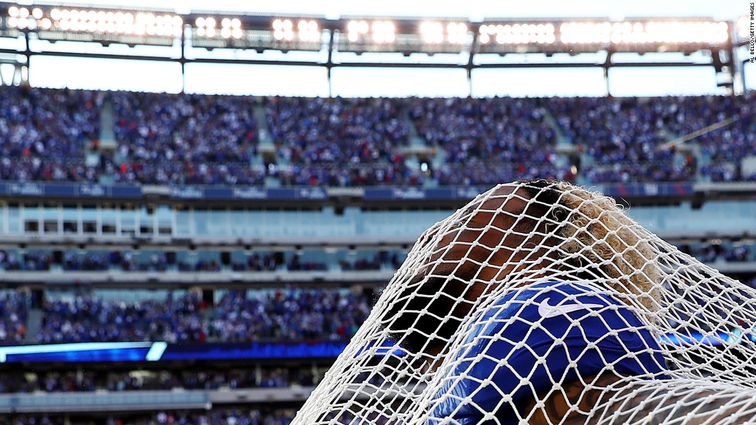 "New York Giants wide receiver Odell Beckham sticks his head through a sideline kicking net after scoring the go-ahead touchdown against Baltimore on Sunday, October 16. Beckham and the net have had <a href=""http://nypost.com/2016/10/16/odell-beckham-takes-the-plunge-with-kicking-net/"" target=""_blank"">an interesting relationship,</a> to say the least. Beckham attacked the net in anger three weeks before this, and then a couple of games later he hugged the net to ""make up."" This time around, he even got on one knee in a mock proposal."