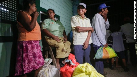 "People from nearby communities wait to be taken to shelters before the arrival of Hurricane Otto in Bluefields, Nicaragua on November 23, 2016.  A Caribbean storm verging on a hurricane spun towards the coasts of Costa Rica and Nicaragua on Wednesday, prompting evacuations and red alerts ahead of ""life-threatening"" flash flooding. / AFP / INTI OCON        (Photo credit should read INTI OCON/AFP/Getty Images)"